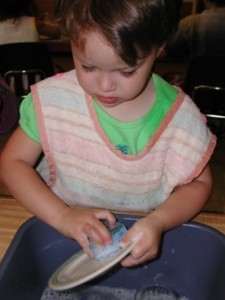 Washing-Dishes-At-Montessori-Kindergarten